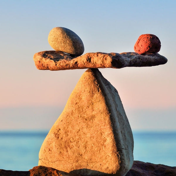 Rocks Balancing on a Larger Rock