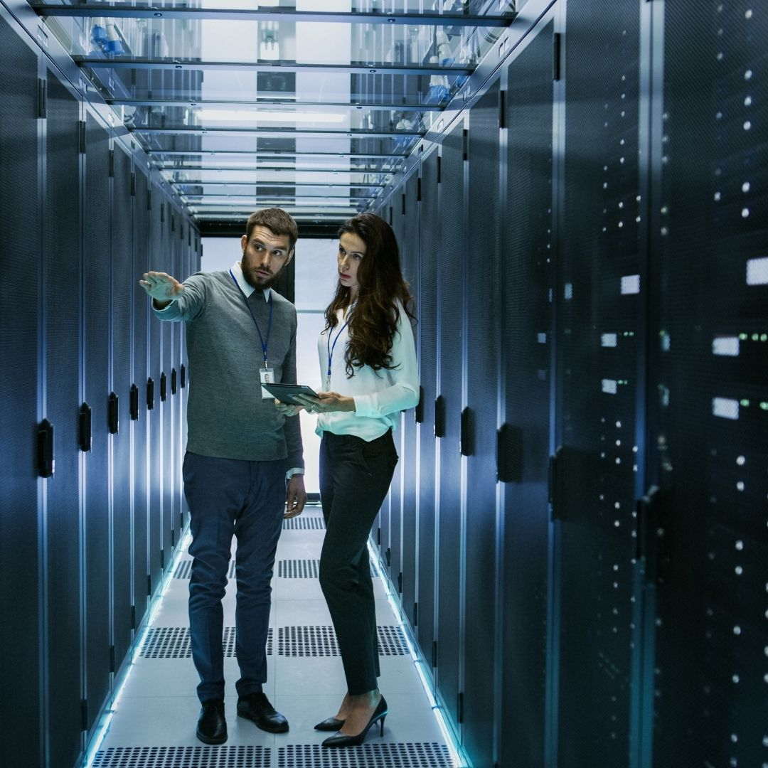 Two Colleagues Working in a Data Center