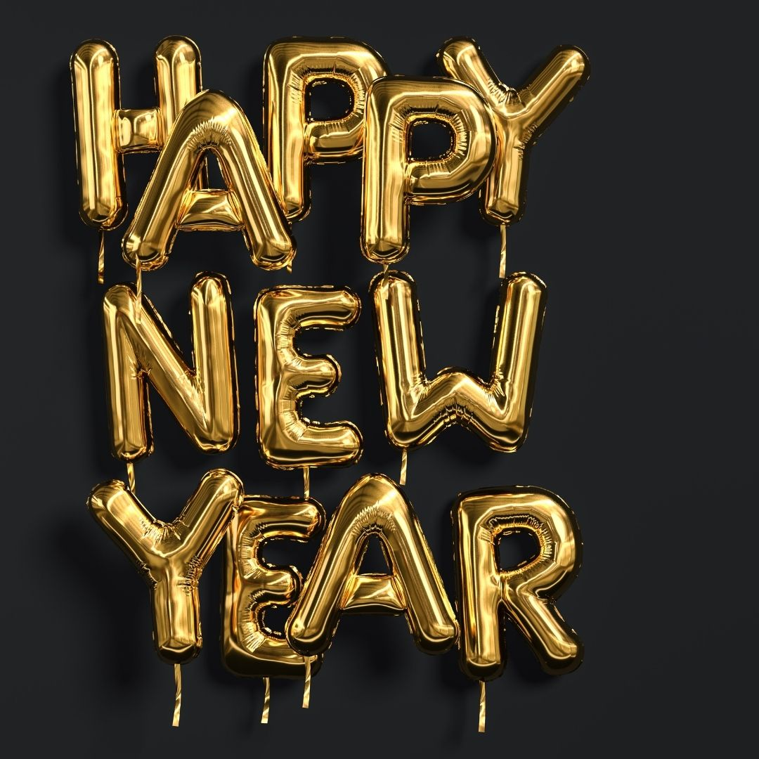 """The Words """"Happy New Year"""" Written in Golden Balloons Against a Black Background."""