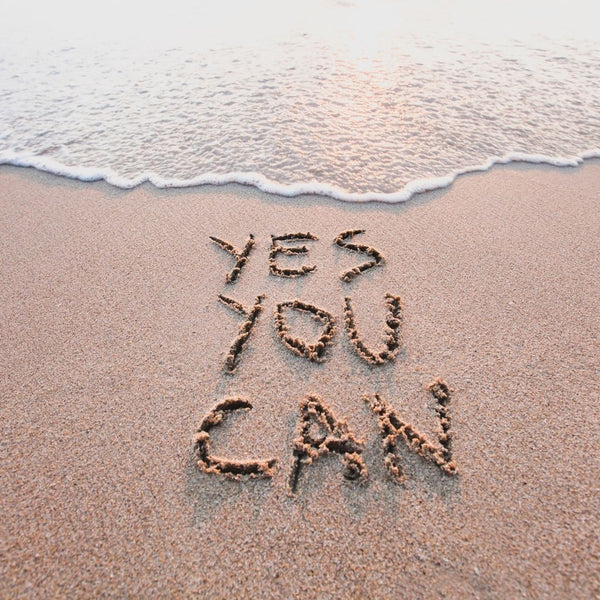 """Yes You Can"" Written in the Sand on a Beach"