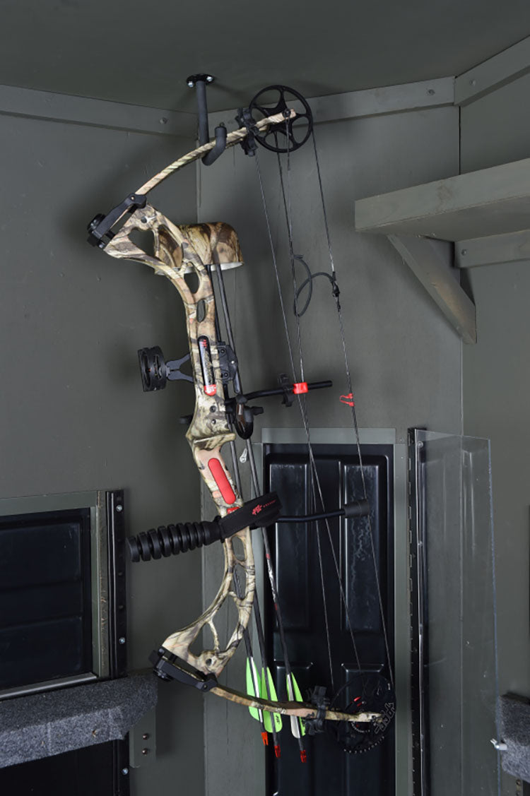 a bow hanging up inside a blind