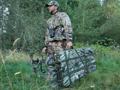 a man carrying a hunting blind