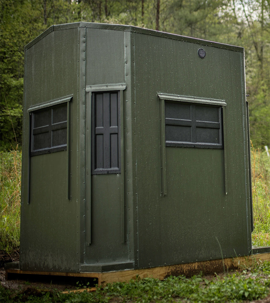 a shadow hunter blind set up in a forest