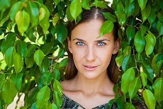 image of a woman in foliage