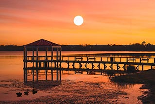 image of a dock at sunset