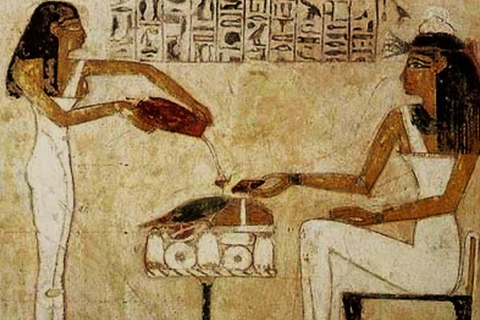 Egyptian hieroglyphics showing women pouring beer