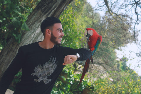 happy person with parrot