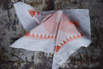 Dove grey linen napkin printed with copper ink.