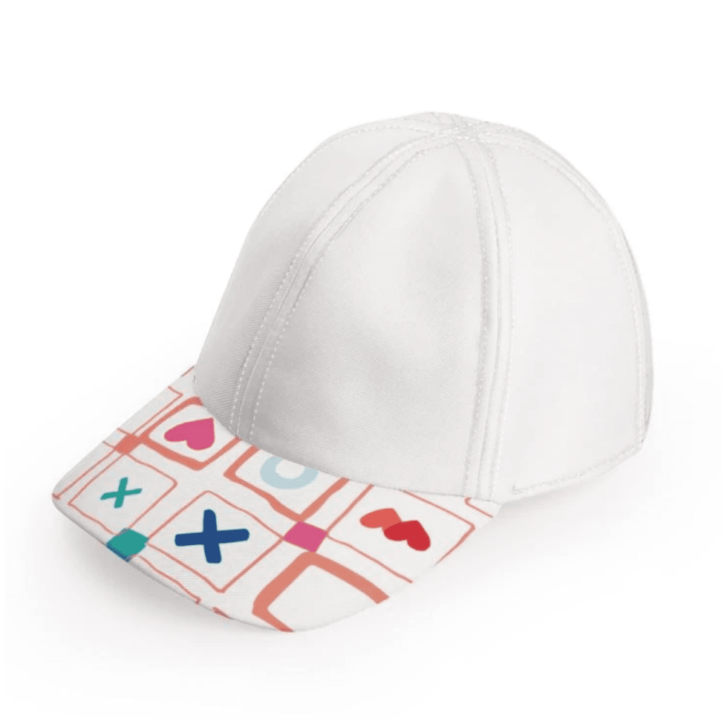 A front view of the bubuleh keppie cap in blanche white, with a gray body and a patterned rim with vibrant colored Xs, Os and hearts.