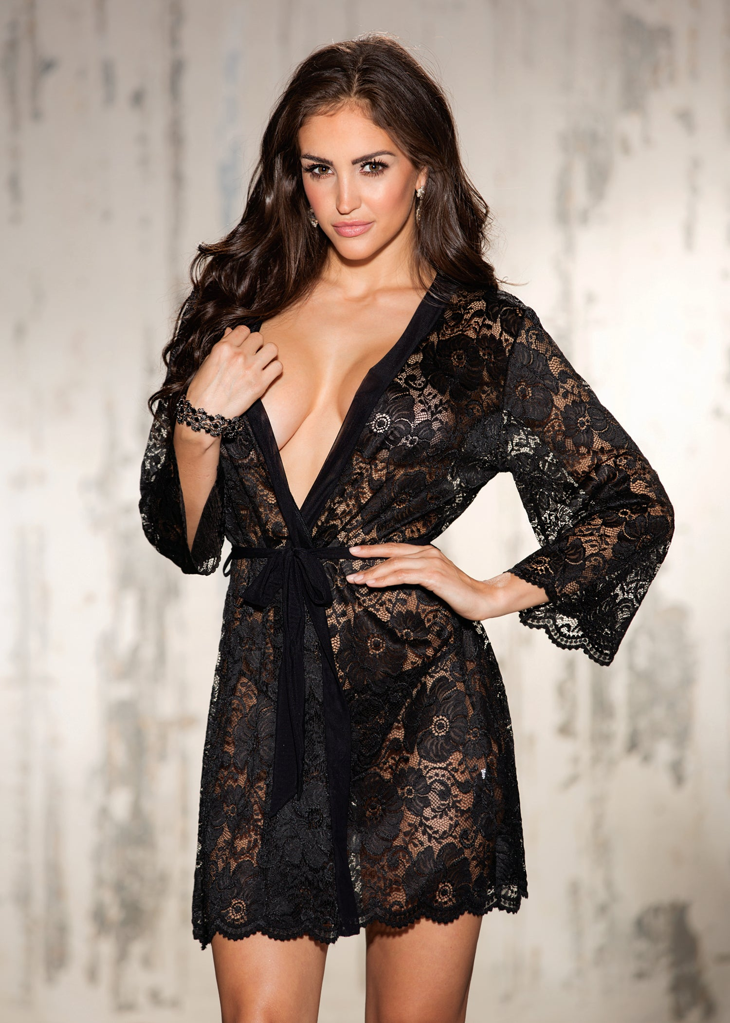 Beautiful stretch lace robe trimmed with mesh band and tie belt. Comes with stretch lace g-string.