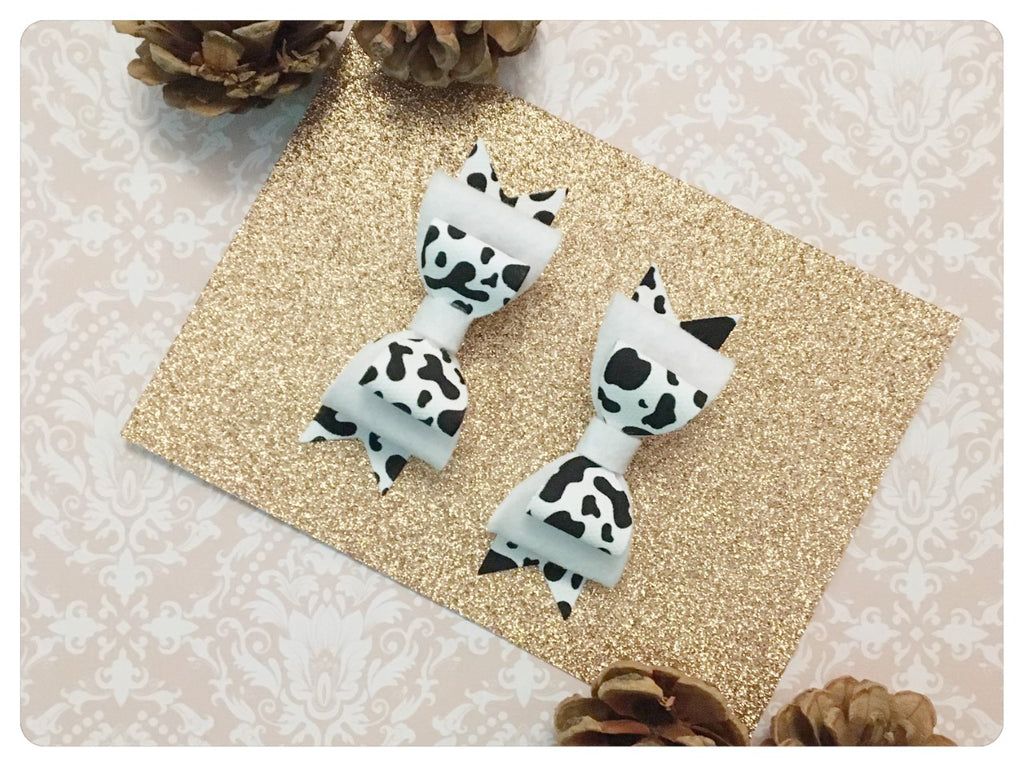 Set of 2 Mini Black & White Faux Leather & Wool Felt Cow Print Pigtail Bows