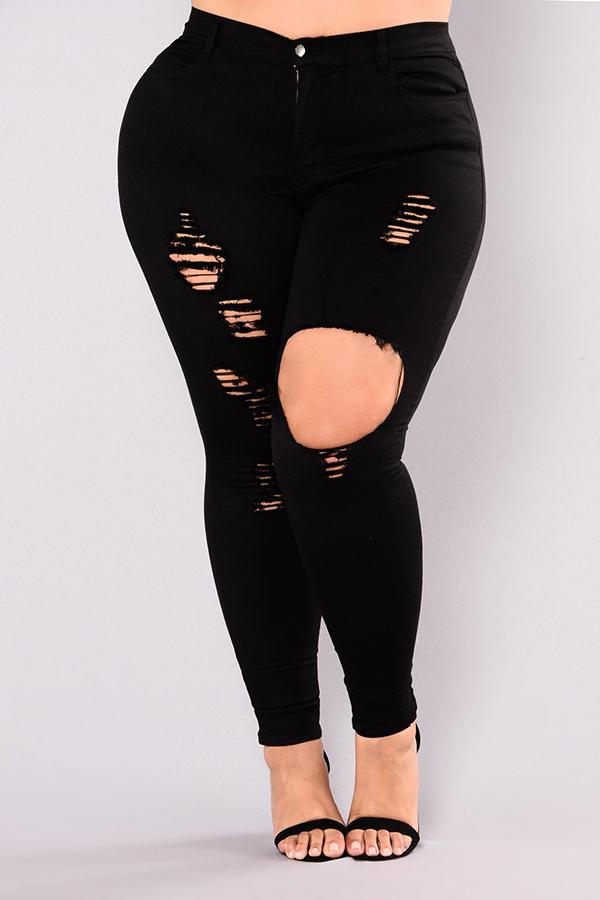 Plus size slim fit jeans with big holes