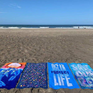 SCIENCE EATS PLASTIC! by Nikkolas Smith Beach Towel Ocean Love