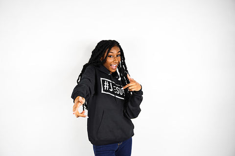 Girl Wearing a black #Jesus hoodie pointing and smiling