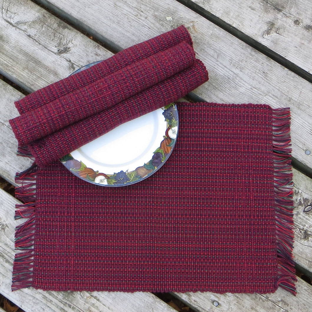 Set: 4 Multicolour Placemats (Burgundy with Red, Green, Black accents)