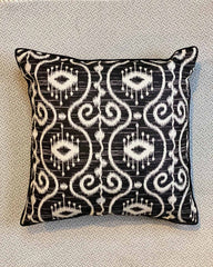 Black and white batik patterned cushion cover.