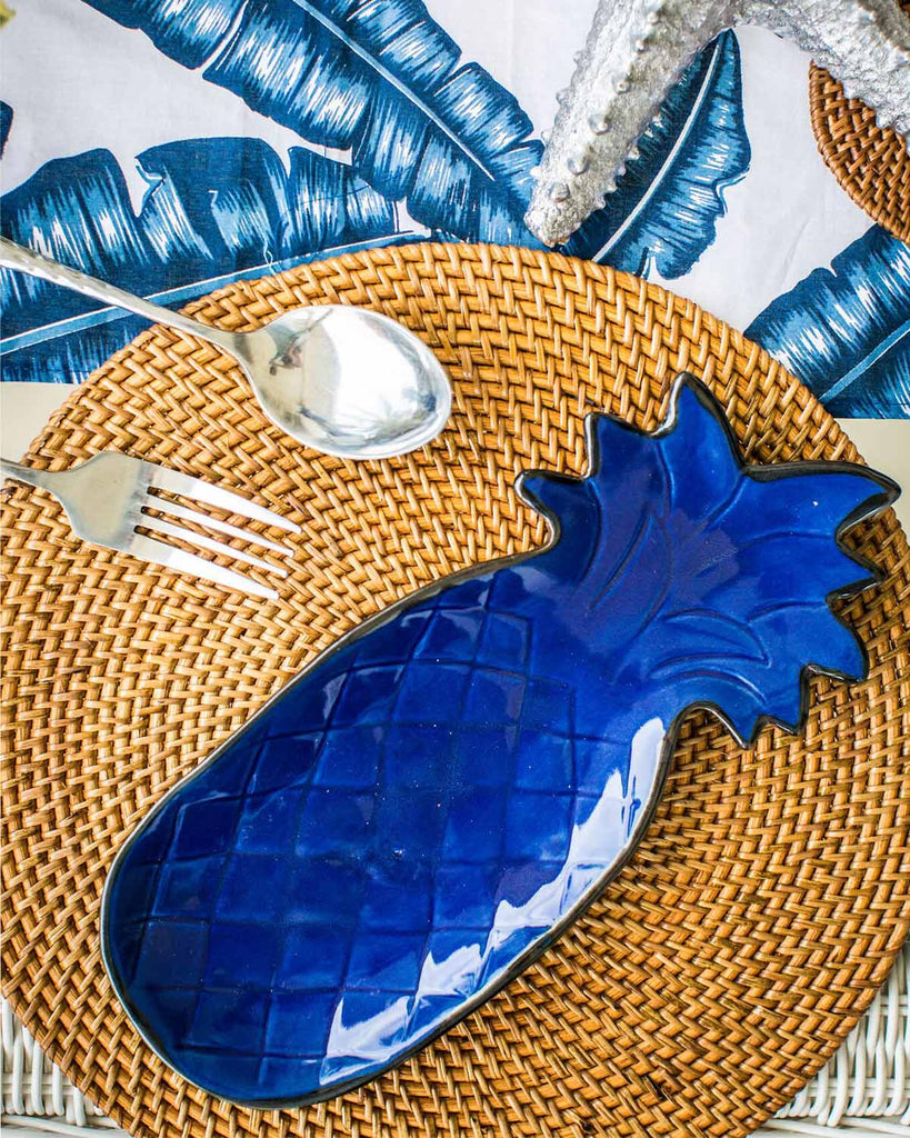 Blue ceramic pineapple dish, pictured on rattan placemat.
