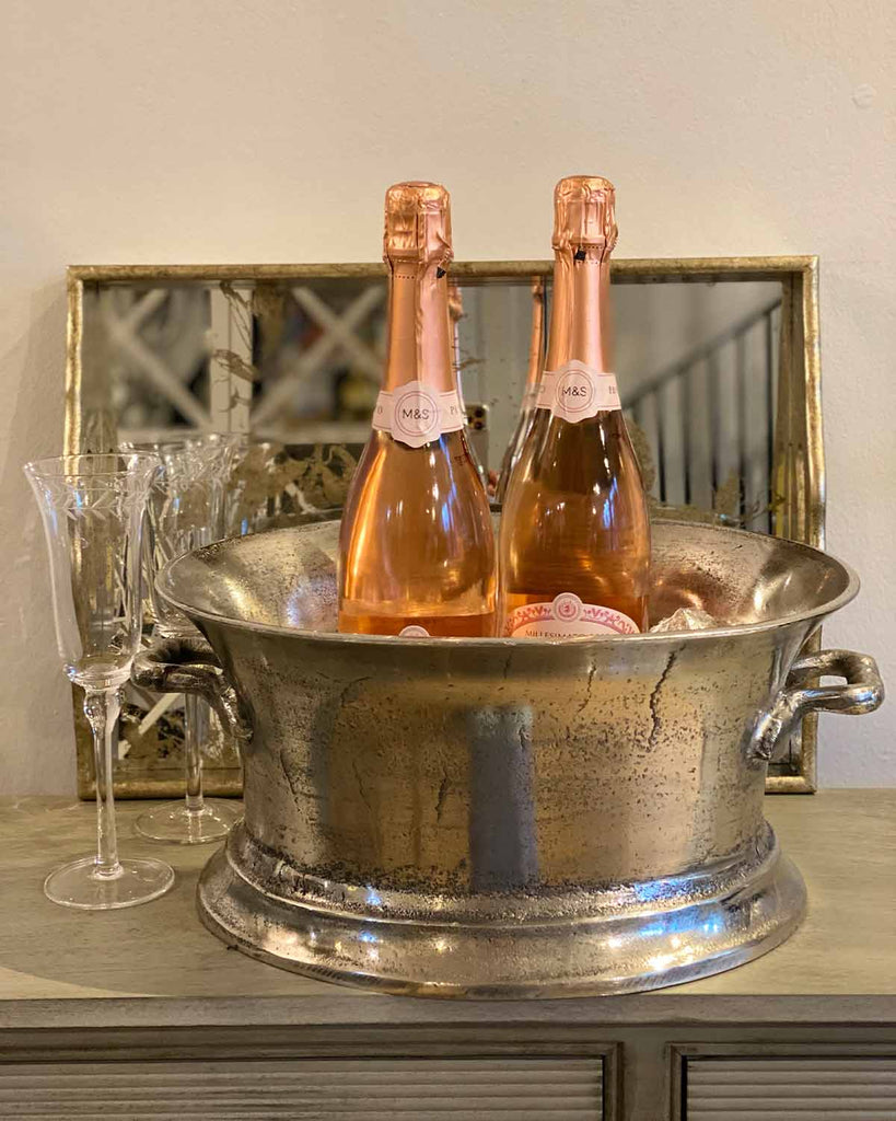Large silver champagne ice bucket.