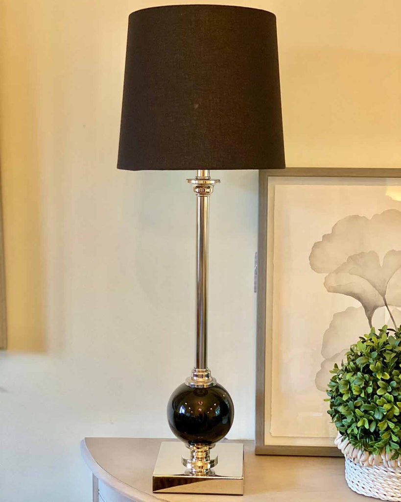 Silver table lamp with black nickel detailing, with black shade.