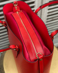 Red shopper bag with big zip detailing on the inside.