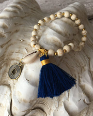 Bali tassel bracelet with beads, a shell and navy tassel.