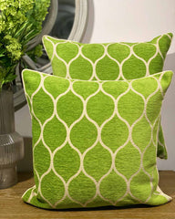 Two cushion covers, printed in moroccan green and white circle design.