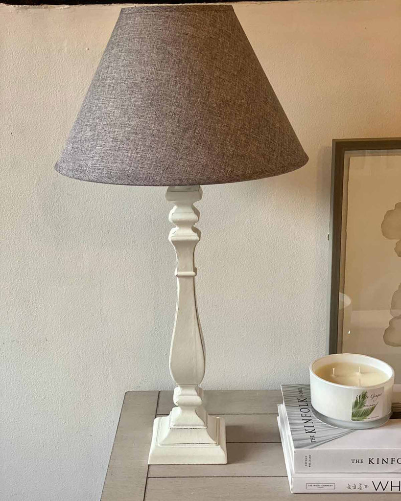 French style wooden cream table lamp with a dark grey shade.
