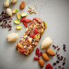 Goji Berry Trailmix bar unwrapped with whole ingredients