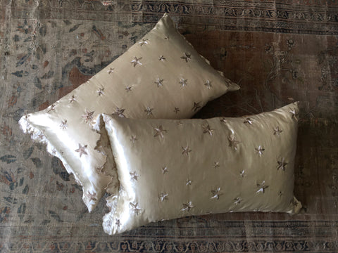 pair bespoke cushions ottoman pearl greay silk satin with rmbroiderd silver stars