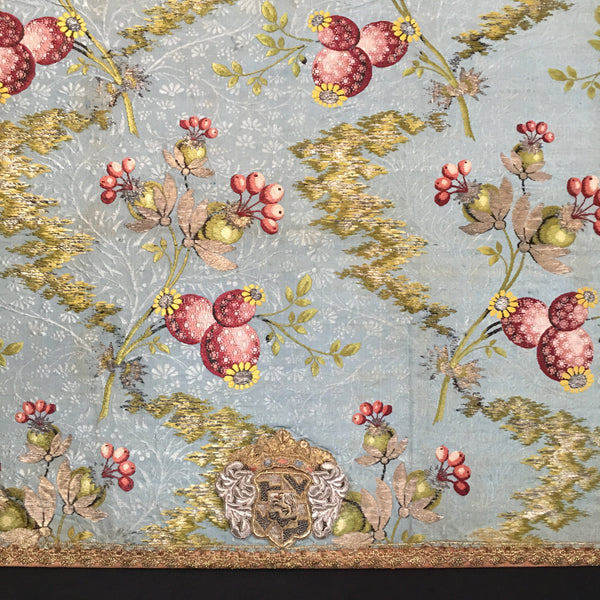 detail 18th century silk brocade mounted with crest