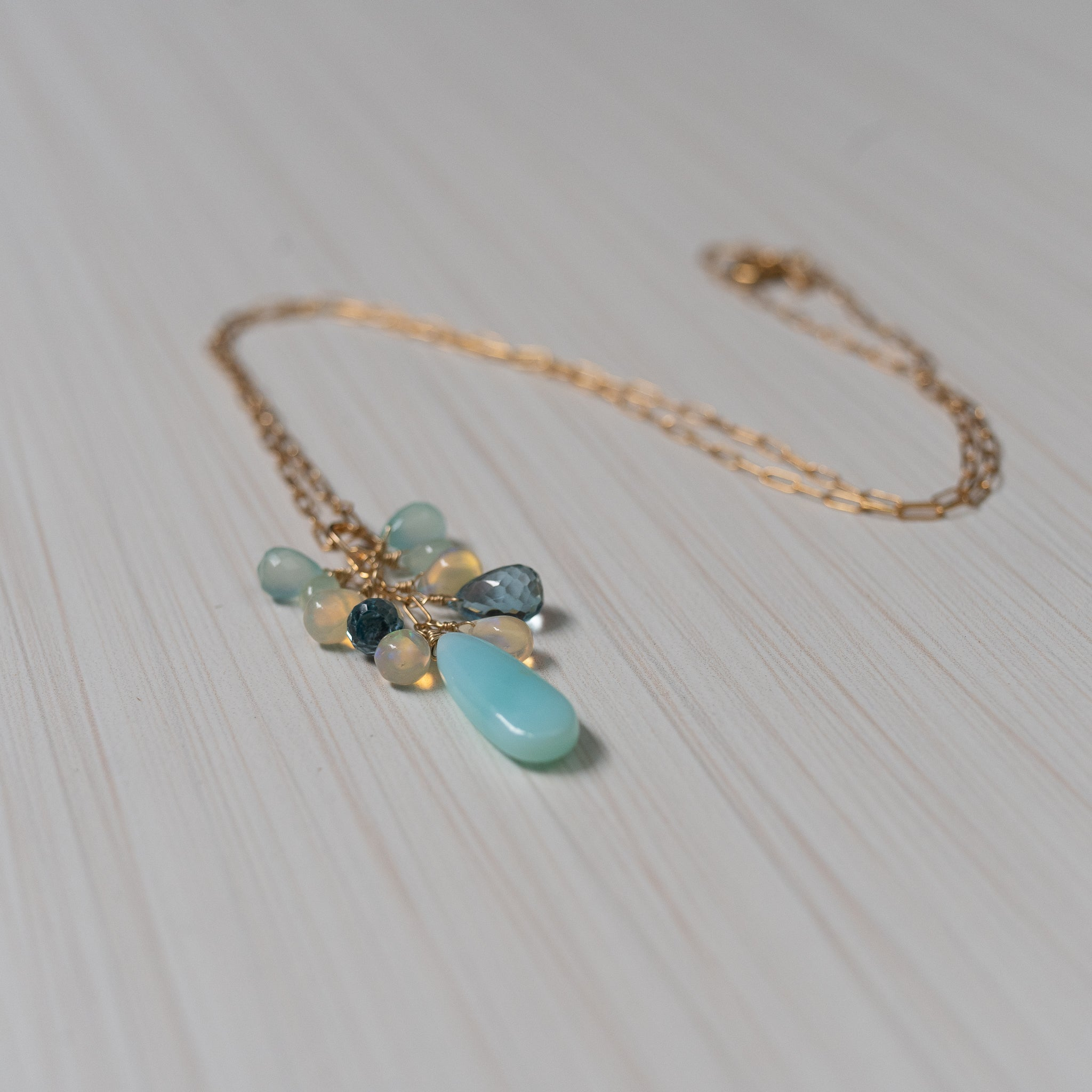 peruvian opal, ethiopian opal , london topaz necklace , handmade in hawaii, by eve black  Edit alt text