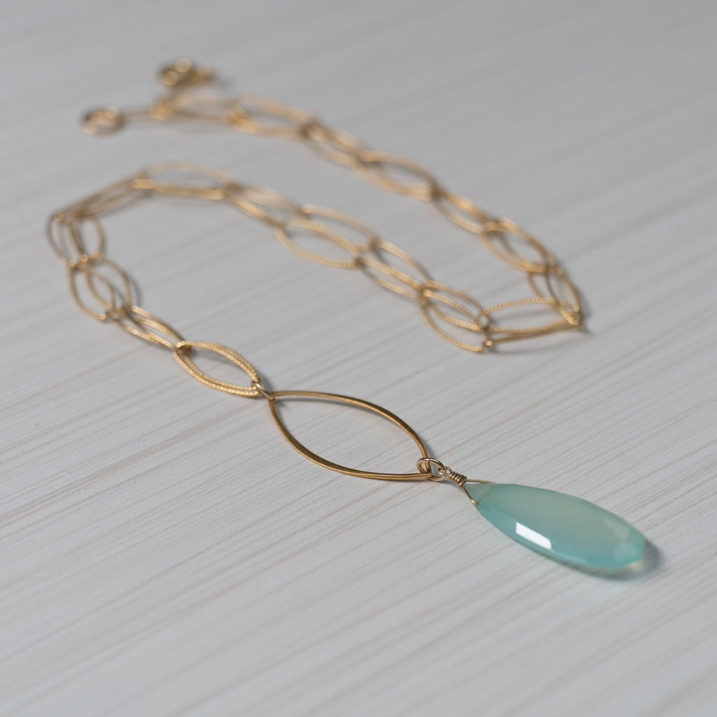 blue gemstone gold necklace handmade in Hawaii by eve black jewelry