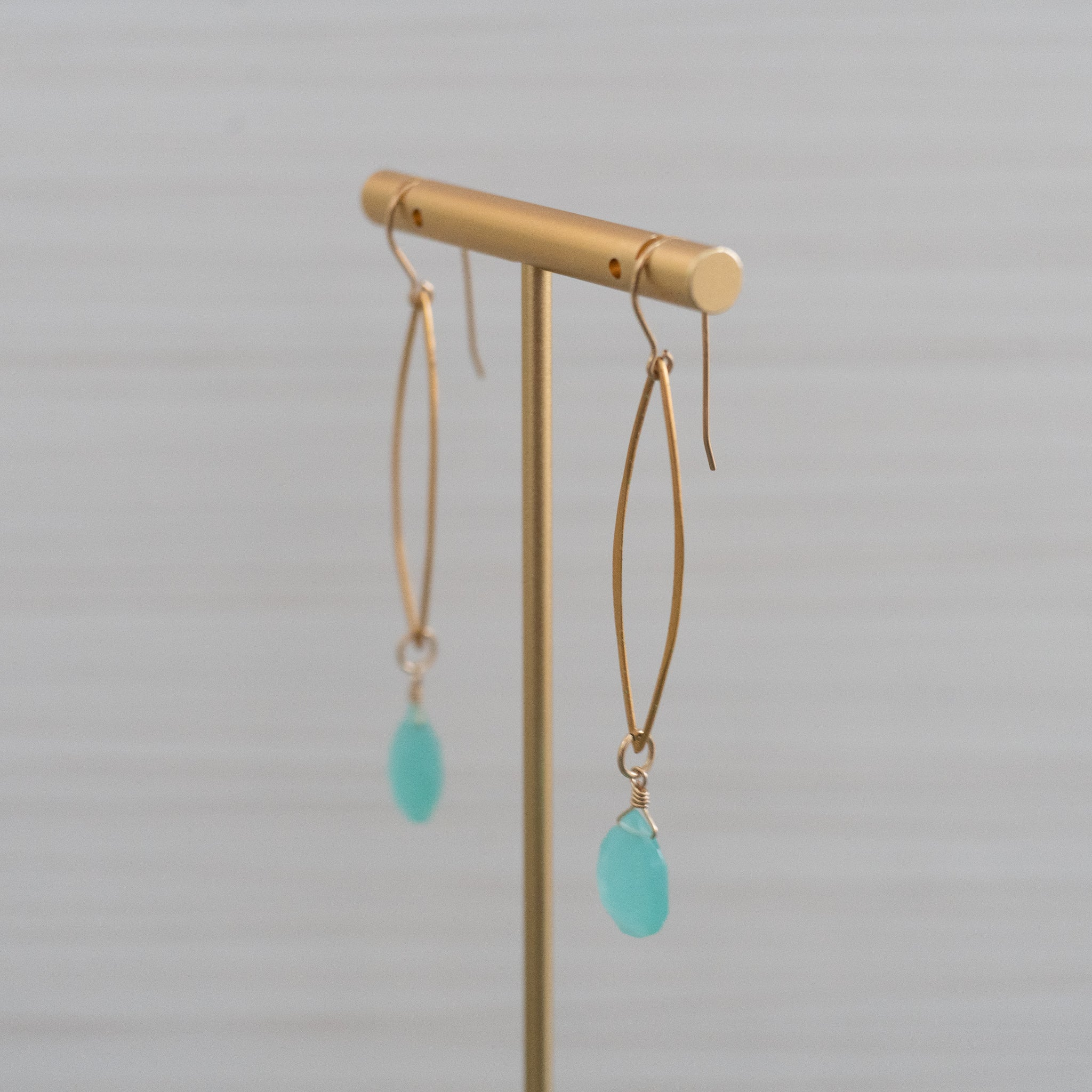 blue gemstones long marquee gold earrings