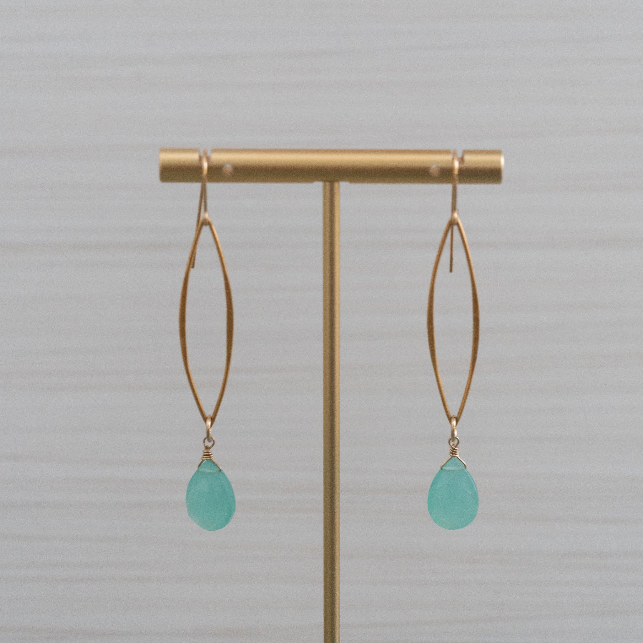 blue gemstones long marquee gold earrings  Edit alt text