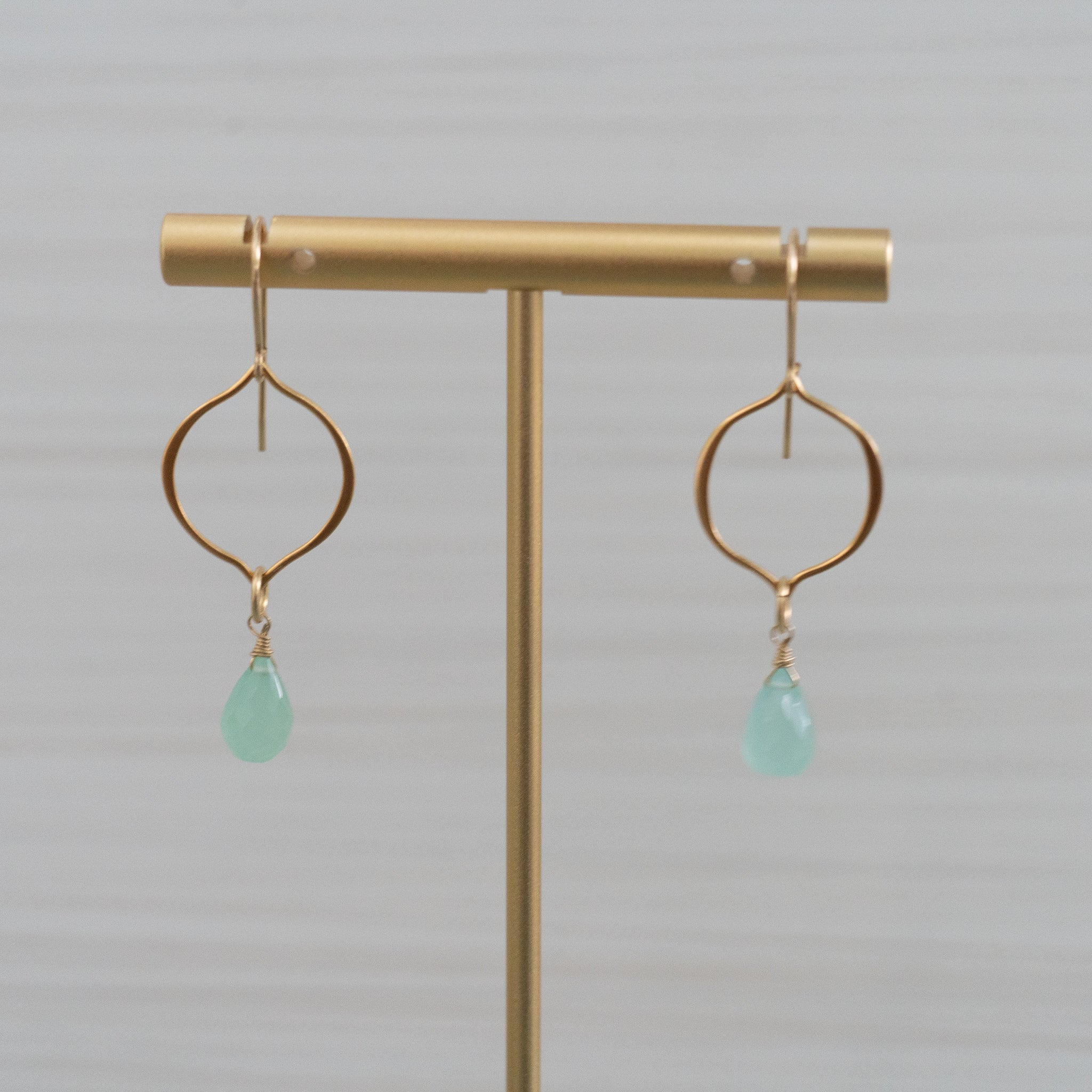 blue gemstones arabesque shape gold earrings  Edit alt text