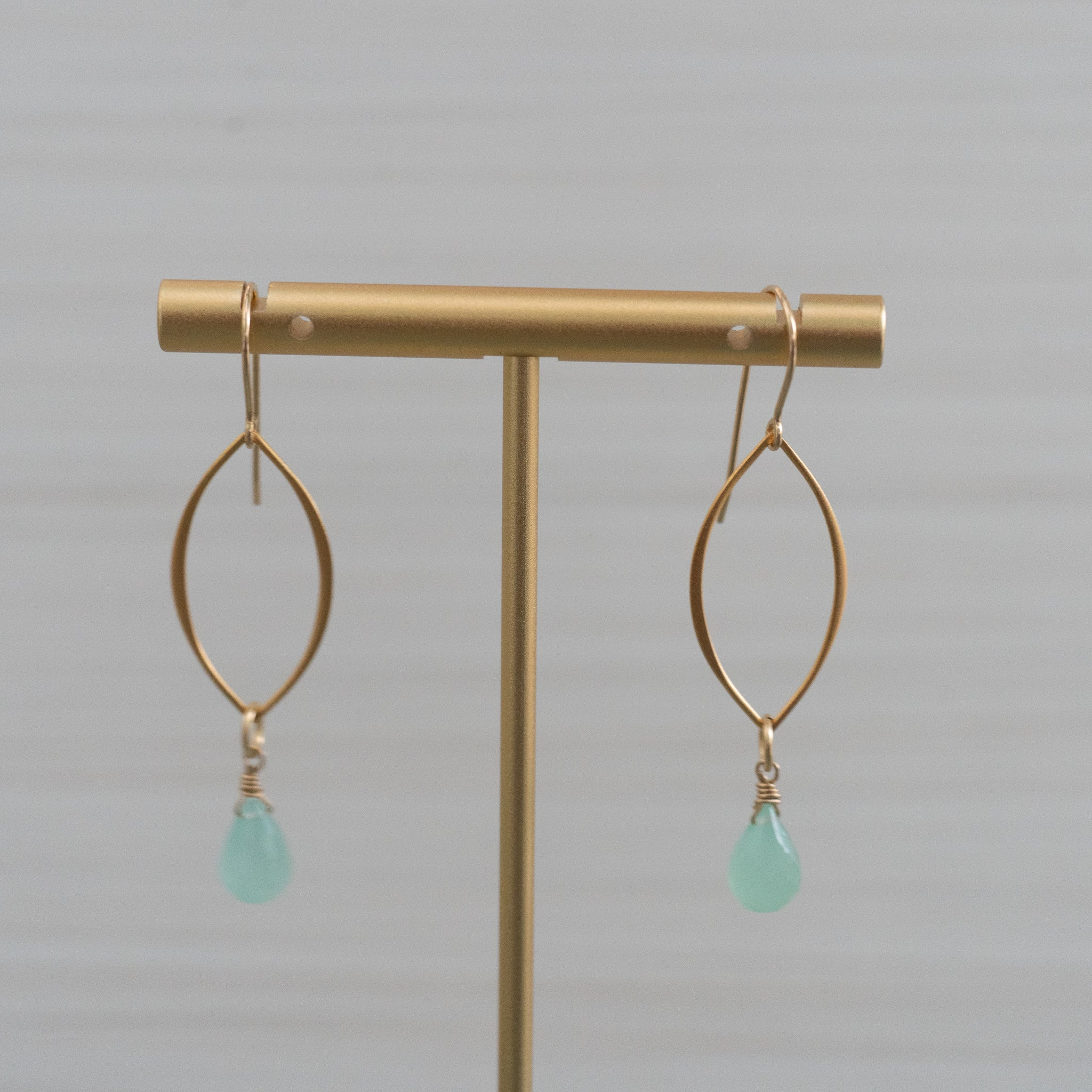 blue gemstone medium marquise shape gold earrings  Edit alt text