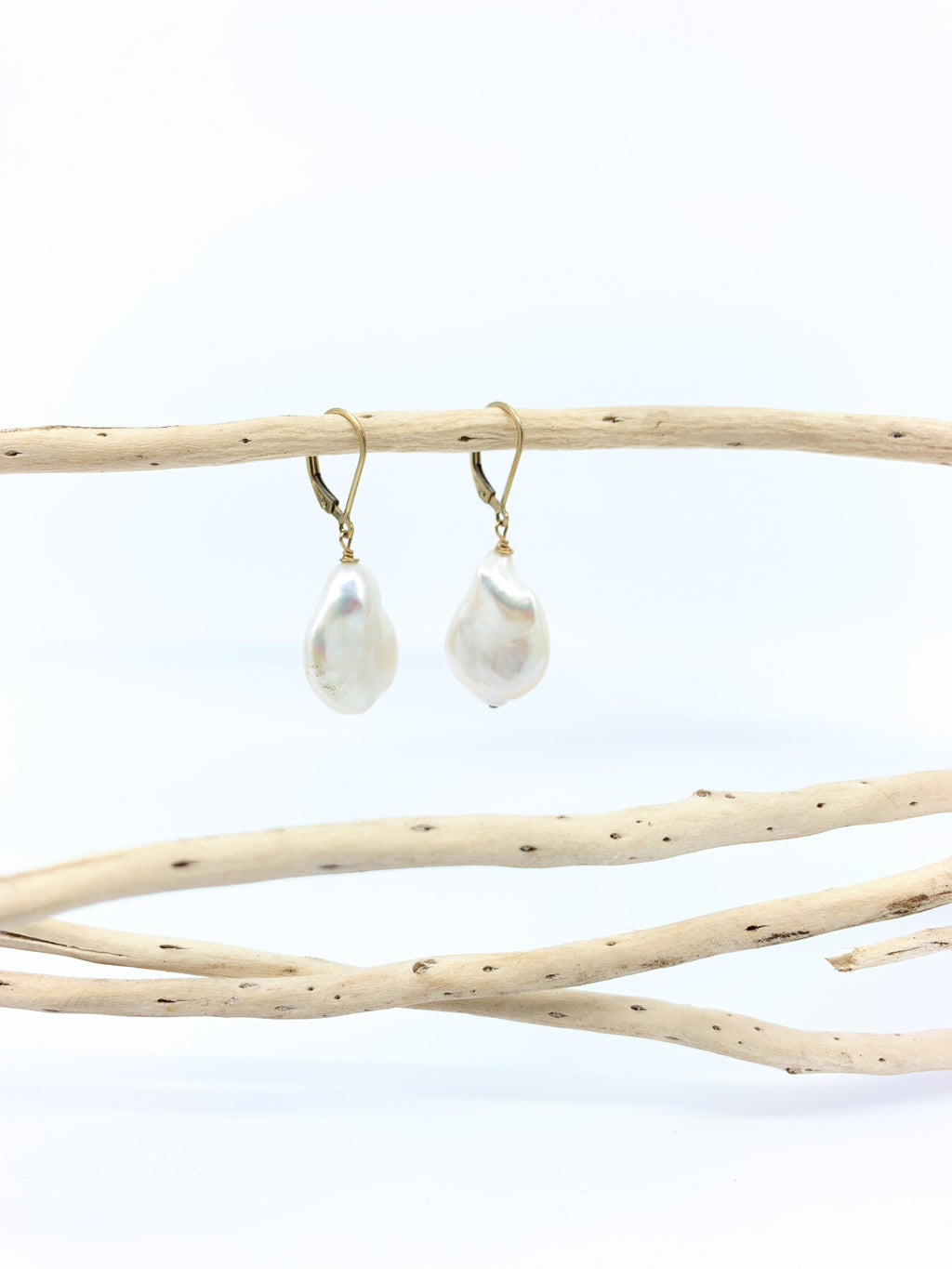 large white baroque pearl earrings with safety ear wires by eve black jewelry made in hawaii