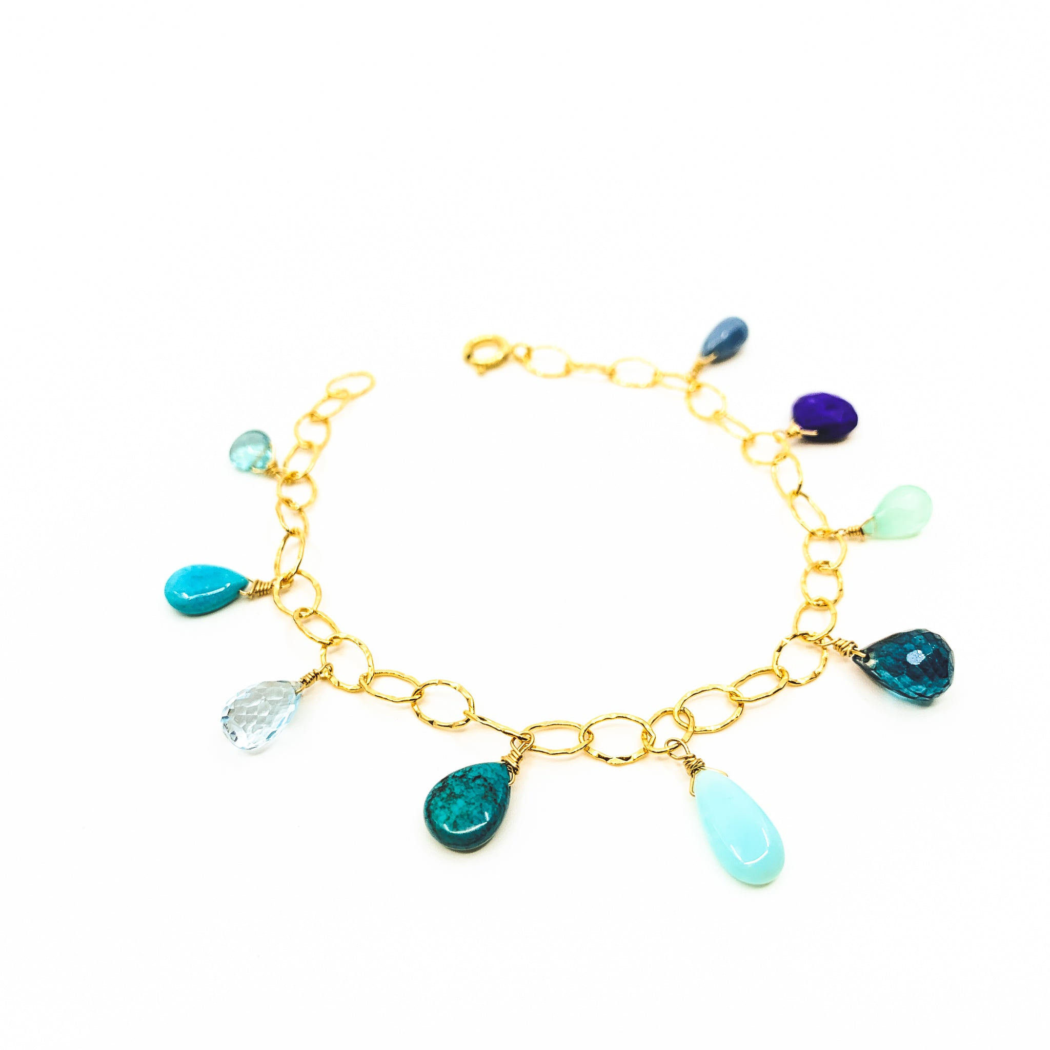 mixed blue gemstones gold charm bracelet by eve black jewelry made in hawaii  Edit alt text