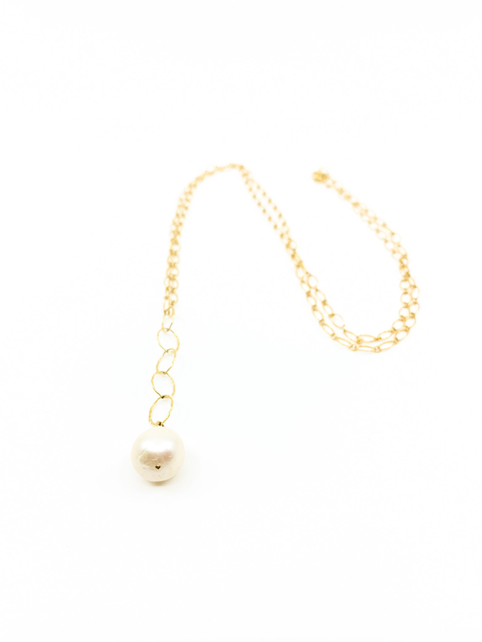 white pearl long gold necklace by eve black jewelry made in Hawaii