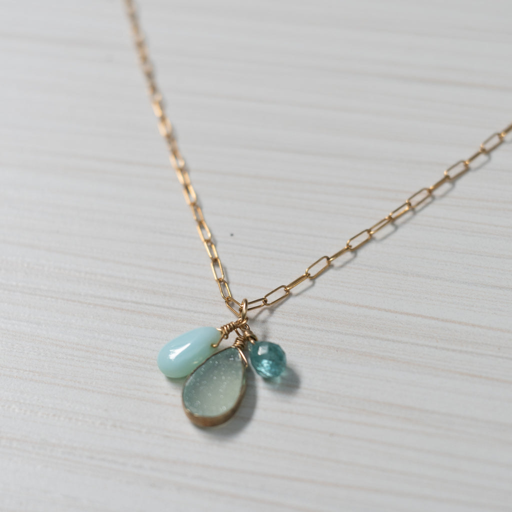 blue gemstones on simple gold necklace handmade in Hawaii by eve black jewelry