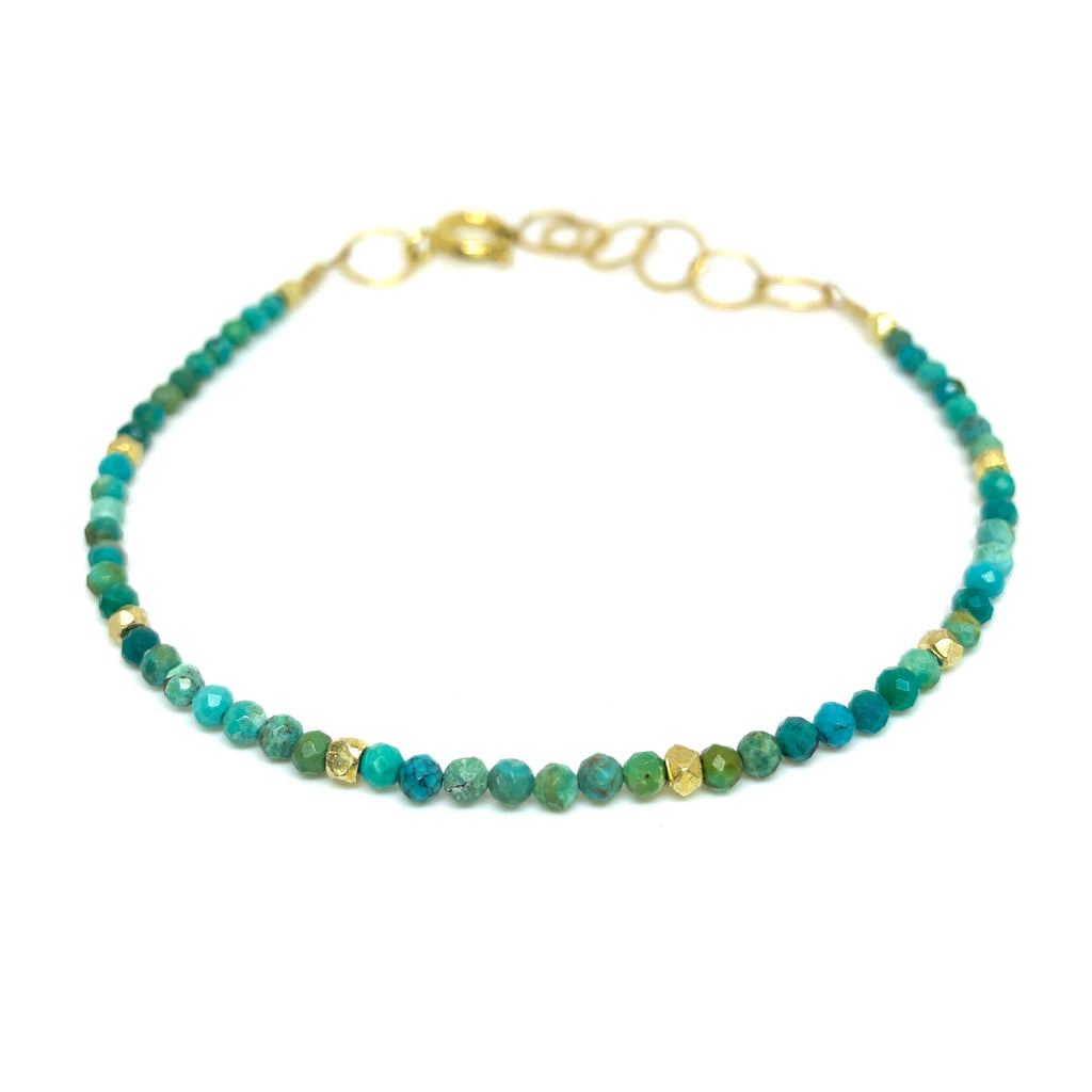 faceted turquoise bracelet with 22 karat vermeil nuggets by eve black jewelry , handmade in Hawaii