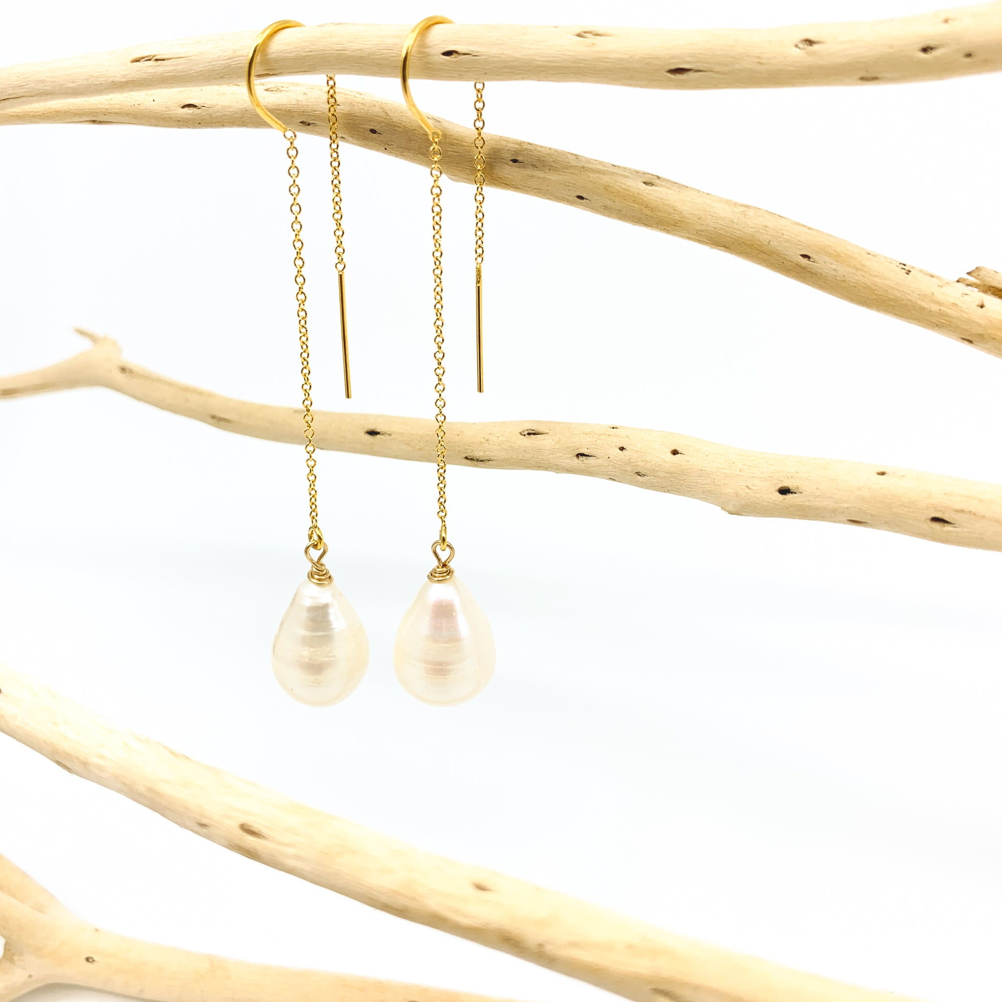 white pearl threader chain style earrings by eve black jewelry made in Hawaii  Edit alt text