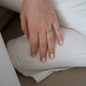 A female hand resting on white jeans wearing Coconut Cream nail polish a creamy white gloss shade