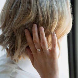 Molly Smyth clutching the side of her head, wearing Iced Latte a light and creamy nude brown nail polish