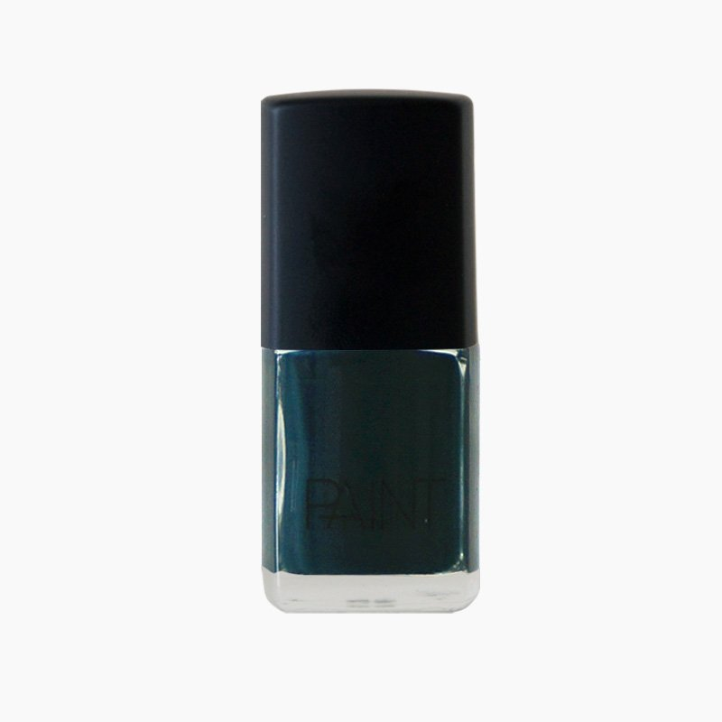 A bottle of Sea queen nail polish by Paint Nail Lacquer against a white backdrop, this shade is a dark teal green.