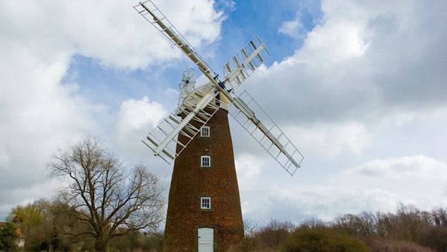 Windmills create a romntic vision of bread. Today's bread is made very differently..