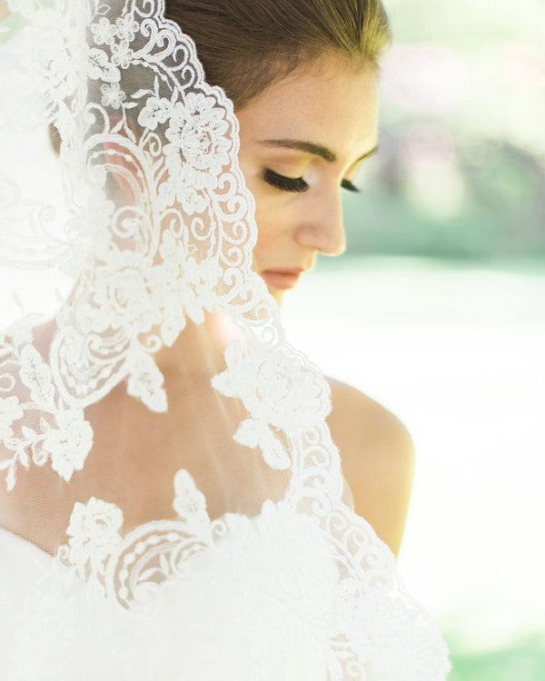 Model wearing Whispering Roses Beaded Lace Chapel wedding Veil