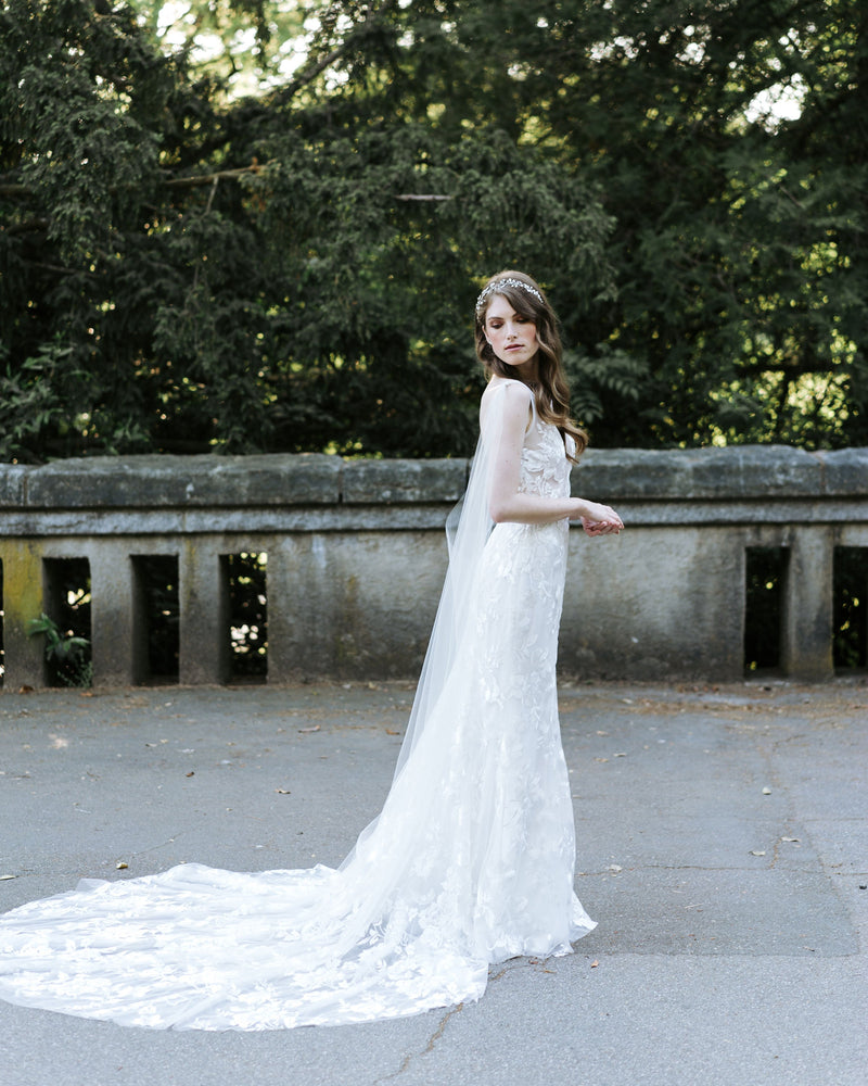 Model wearing Aster cape wedding veil