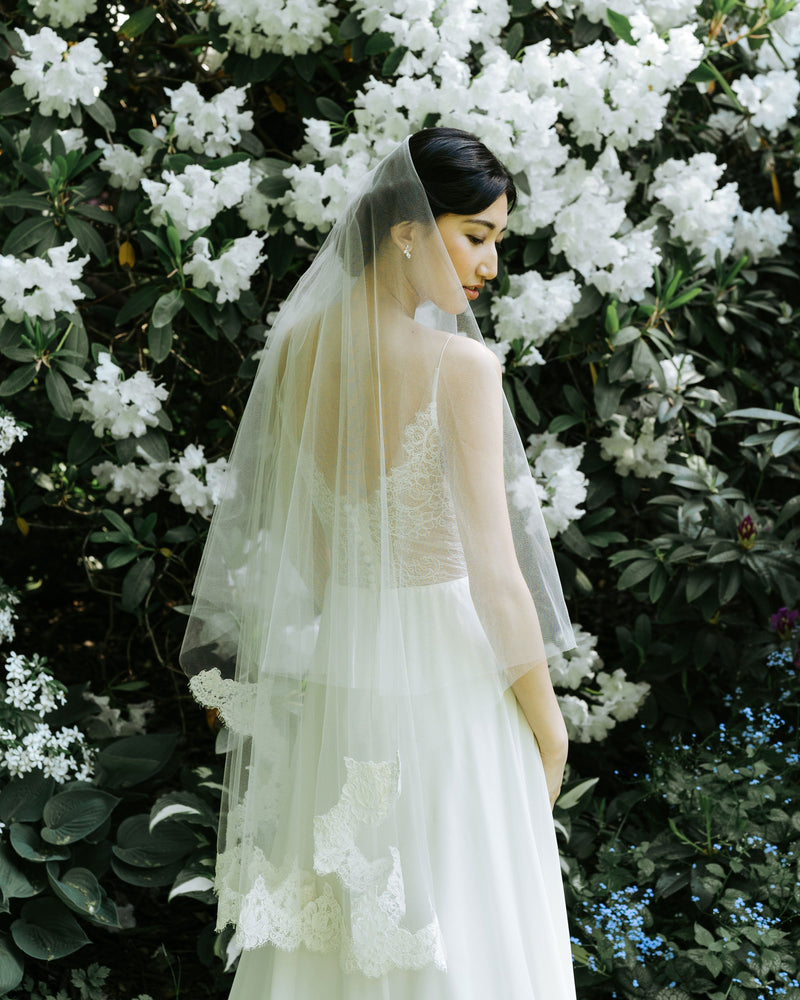 model wearing Azalea fingertip lace wedding veil