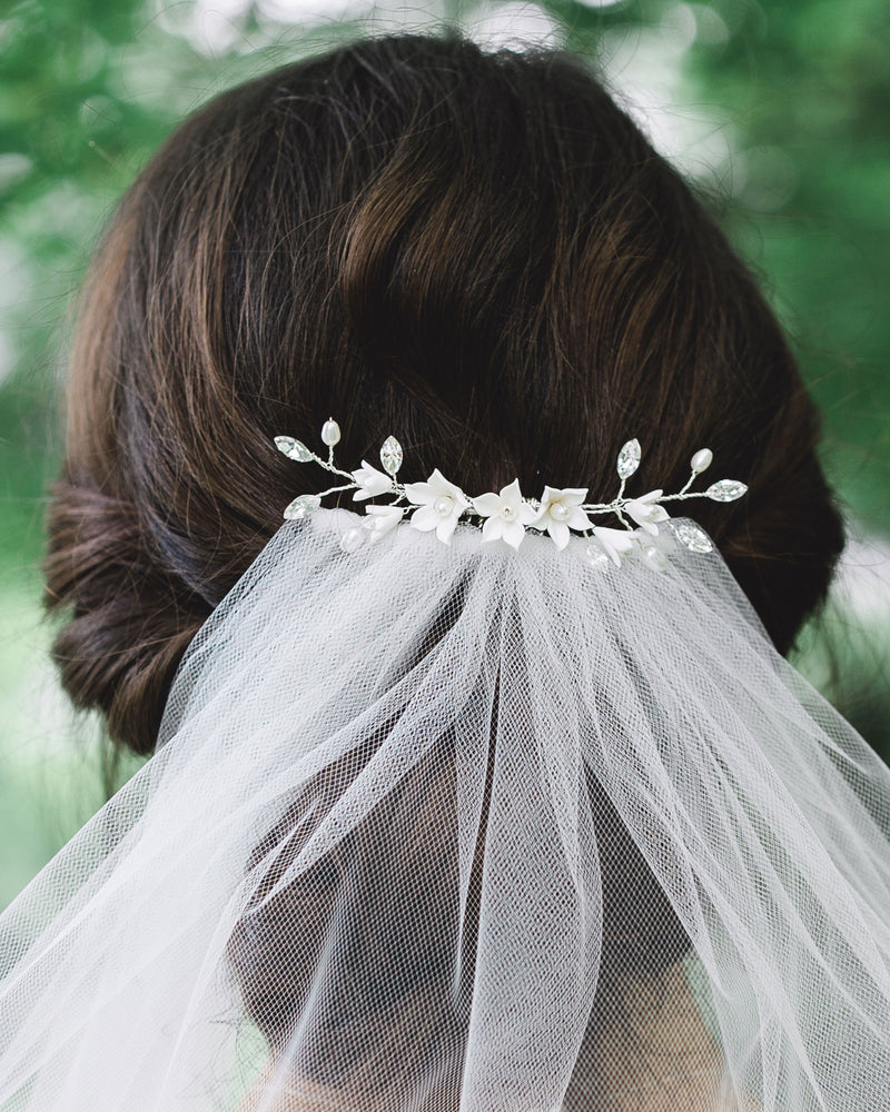Model wearing belle fleur silver wedding hair comb swarovski crystals and fresh water pearl